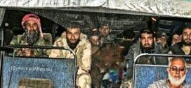 Med busslaster kommer jihadister til Idlib, 2018.