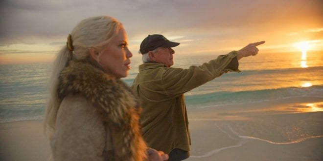 Paul Craig Roberts on the beach with Hanne Herland