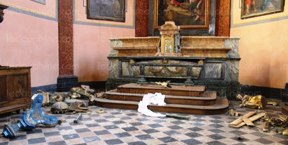 The vandalized altar of a historic church in Thonon-les-Bains, France.